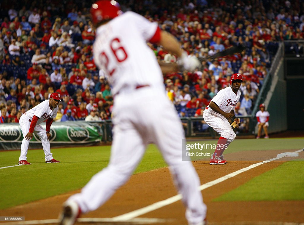 <a gi-track='captionPersonalityLinkClicked' href=/galleries/search?phrase=Chase+Utley&family=editorial&specificpeople=161391 ng-click='$event.stopPropagation()'>Chase Utley</a> #26 of the Philadelphia Phillies grounds out to second base as <a gi-track='captionPersonalityLinkClicked' href=/galleries/search?phrase=Juan+Pierre&family=editorial&specificpeople=202961 ng-click='$event.stopPropagation()'>Juan Pierre</a> #10 prepares to score in the first inning against the Atlanta Braves during a MLB baseball game on September 21, 2012 at Citizens Bank Park in Philadelphia, Pennsylvania. The Phillies defeated the Braves 6-2.