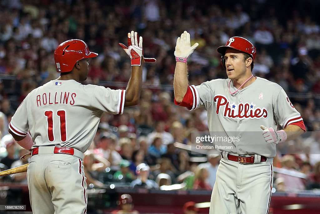<a gi-track='captionPersonalityLinkClicked' href=/galleries/search?phrase=Chase+Utley&family=editorial&specificpeople=161391 ng-click='$event.stopPropagation()'>Chase Utley</a> #26 of the Philadelphia Phillies high fives <a gi-track='captionPersonalityLinkClicked' href=/galleries/search?phrase=Jimmy+Rollins&family=editorial&specificpeople=204478 ng-click='$event.stopPropagation()'>Jimmy Rollins</a> #11 after scoring a 10th inning run against the Arizona Diamondbacks during the MLB game at Chase Field on May 12, 2013 in Phoenix, Arizona.