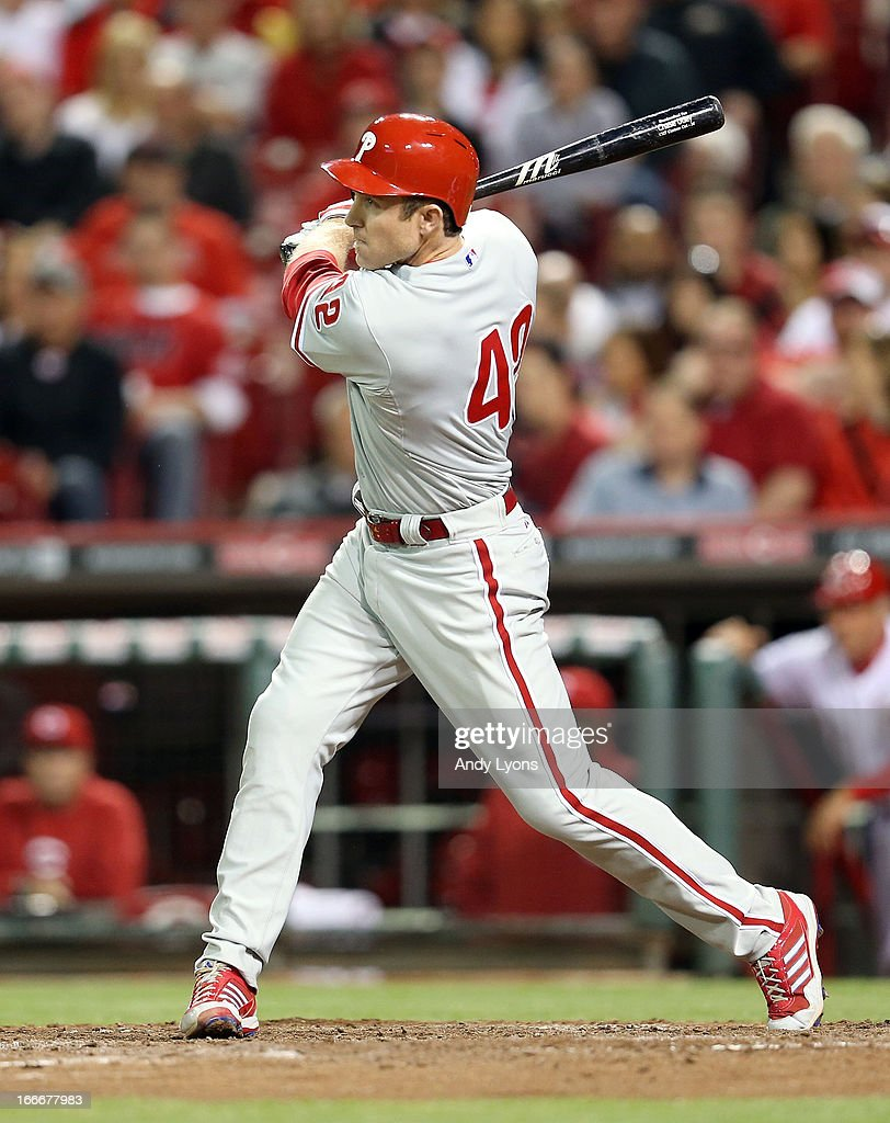 <a gi-track='captionPersonalityLinkClicked' href=/galleries/search?phrase=Chase+Utley&family=editorial&specificpeople=161391 ng-click='$event.stopPropagation()'>Chase Utley</a> #42 of the Philadelphia Phillies hits a home run in the 8th inning during the game against the Cincinnati Reds at Great American Ball Park on April 15, 2013 in Cincinnati, Ohio. All uniformed team members are wearing jersey number 42 in honor of Jackie Robinson Day.