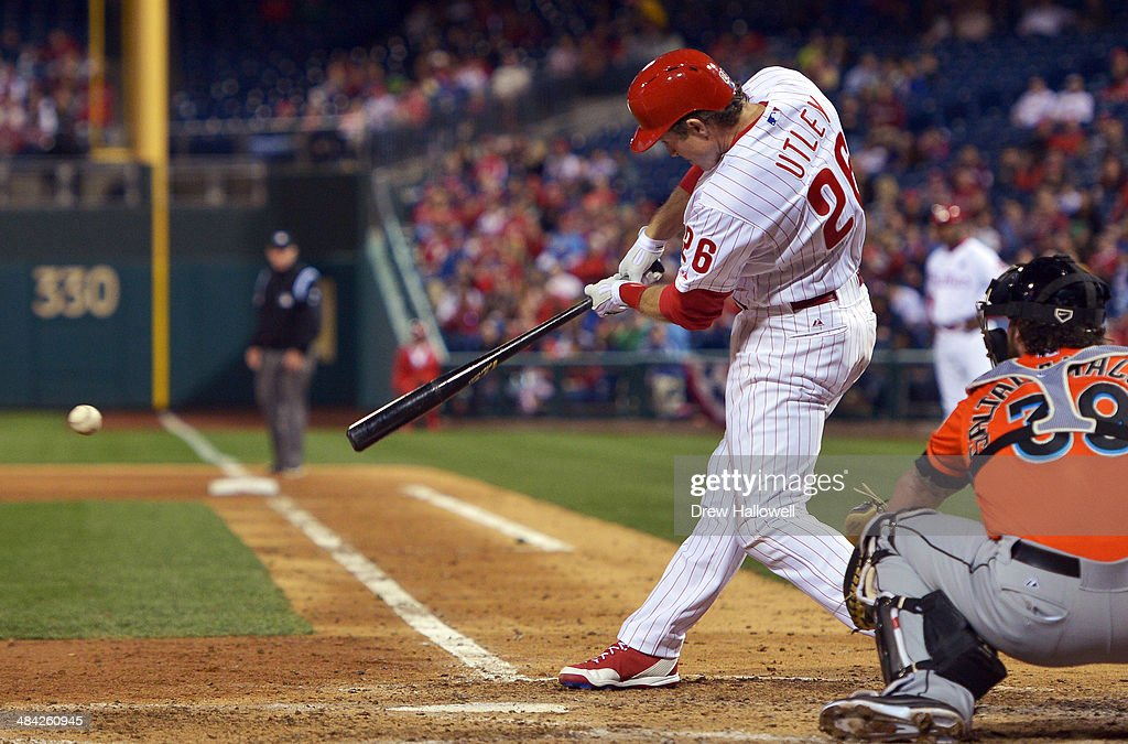 <a gi-track='captionPersonalityLinkClicked' href=/galleries/search?phrase=Chase+Utley&family=editorial&specificpeople=161391 ng-click='$event.stopPropagation()'>Chase Utley</a> #26 of the Philadelphia Phillies hits a one run single in the fifth inning against the Miami Marlins at Citizens Bank Park on April 11, 2014 in Philadelphia, Pennsylvania. The Phillies won 6-3.