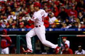 Chase Utley of the Philadelphia Phillies hits a RBI single to drive in Shane Victorino in the bottom of the sixth inning against the Los Angeles...