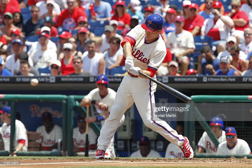 <a gi-track='captionPersonalityLinkClicked' href=/galleries/search?phrase=Chase+Utley&family=editorial&specificpeople=161391 ng-click='$event.stopPropagation()'>Chase Utley</a> #26 of the Philadelphia Phillies hits a single in the first inning during a game against the Atlanta Braves at Citizens Bank Park on July 7, 2013 in Philadelphia, Pennsylvania.
