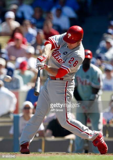 Chase Utley of the Philadelphia Phillies hits a single in the the first inning against the Los Angeles Dodgers in Game Two of the NLCS during the...