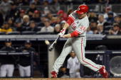 Chase Utley of the Philadelphia Phillies hits a solo home run in the top of the third inning against the New York Yankees in Game One of the 2009 MLB...