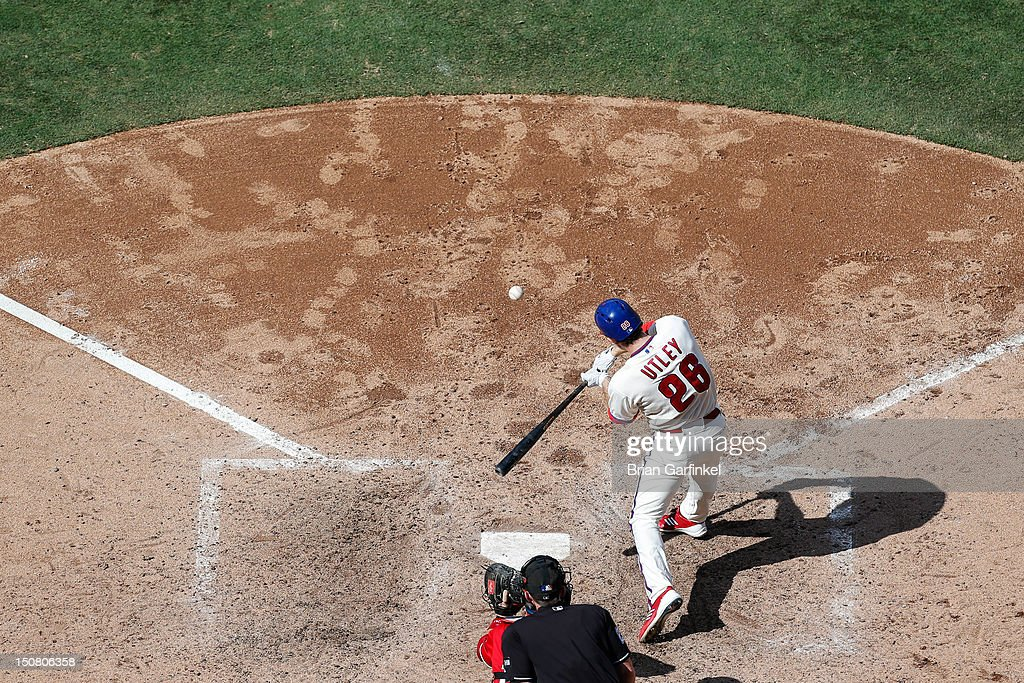 <a gi-track='captionPersonalityLinkClicked' href=/galleries/search?phrase=Chase+Utley&family=editorial&specificpeople=161391 ng-click='$event.stopPropagation()'>Chase Utley</a> #26 of the Philadelphia Phillies hits the ball during the game against the Washington Nationals at Citizens Bank Park on August 26, 2012 in Philadelphia, Pennsylvania. The Phillies won 4-1.