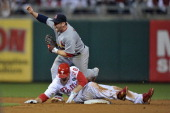 Chase Utley of the Philadelphia Phillies is caught attempting to steal second base in the bottom of the sixth inning against Nick Punto of the St...