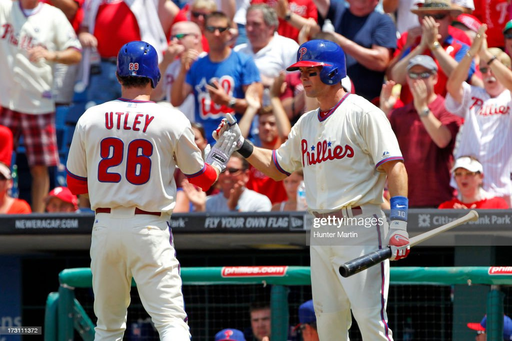 <a gi-track='captionPersonalityLinkClicked' href=/galleries/search?phrase=Chase+Utley&family=editorial&specificpeople=161391 ng-click='$event.stopPropagation()'>Chase Utley</a> #26 of the Philadelphia Phillies is congratulated by <a gi-track='captionPersonalityLinkClicked' href=/galleries/search?phrase=Michael+Young+-+Baseball+Player&family=editorial&specificpeople=203149 ng-click='$event.stopPropagation()'>Michael Young</a> #10 after scoring in the first inning during a game against the Atlanta Braves at Citizens Bank Park on July 7, 2013 in Philadelphia, Pennsylvania.