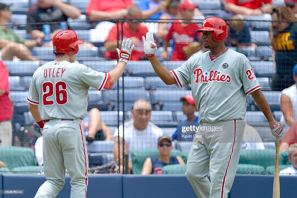 <a gi-track='captionPersonalityLinkClicked' href=/galleries/search?phrase=Chase+Utley&family=editorial&specificpeople=161391 ng-click='$event.stopPropagation()'>Chase Utley</a> #26 of the Philadelphia Phillies is congratulated by Roberto Hernandez #27 after scoring against the Atlanta Braves during the fourth inning at Turner Field on June 18, 2014 in Atlanta, Georgia. The Braves won 10-5.