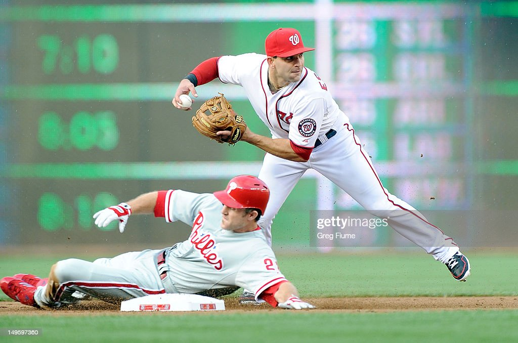 <a gi-track='captionPersonalityLinkClicked' href=/galleries/search?phrase=Chase+Utley&family=editorial&specificpeople=161391 ng-click='$event.stopPropagation()'>Chase Utley</a> #26 of the Philadelphia Phillies is forced out at second base by <a gi-track='captionPersonalityLinkClicked' href=/galleries/search?phrase=Danny+Espinosa&family=editorial&specificpeople=4410764 ng-click='$event.stopPropagation()'>Danny Espinosa</a> #8 of the Washington Nationals at Nationals Park on July 31, 2012 in Washington, DC.
