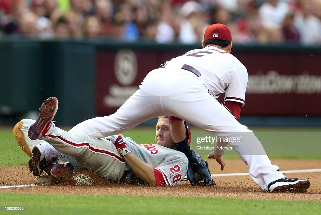 <a gi-track='captionPersonalityLinkClicked' href=/galleries/search?phrase=Chase+Utley&family=editorial&specificpeople=161391 ng-click='$event.stopPropagation()'>Chase Utley</a> #26 of the Philadelphia Phillies is tagged out by infielder <a gi-track='captionPersonalityLinkClicked' href=/galleries/search?phrase=Eric+Chavez&family=editorial&specificpeople=201561 ng-click='$event.stopPropagation()'>Eric Chavez</a> #12 of the Arizona Diamondbacks as he attempts to stretch a double into a triple during the first inning of the MLB game at Chase Field on May 10, 2013 in Phoenix, Arizona.