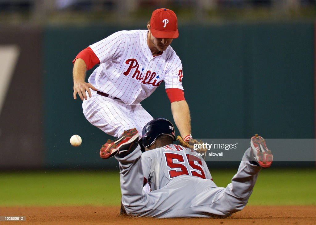 <a gi-track='captionPersonalityLinkClicked' href=/galleries/search?phrase=Chase+Utley&family=editorial&specificpeople=161391 ng-click='$event.stopPropagation()'>Chase Utley</a> #26 of the Philadelphia Phillies is unable to get the tag on Eury Perez #55 of the Washington Nationals as he steals second base at Citizens Bank Park on September 27, 2012 in Philadelphia, Pennsylvania. The Nationals won 7-3.