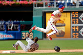 Chase Utley of the Philadelphia Phillies leaps over Alejandro De Aza of the Chicago White Sox on a double play during a game at Citizens Bank Park on...