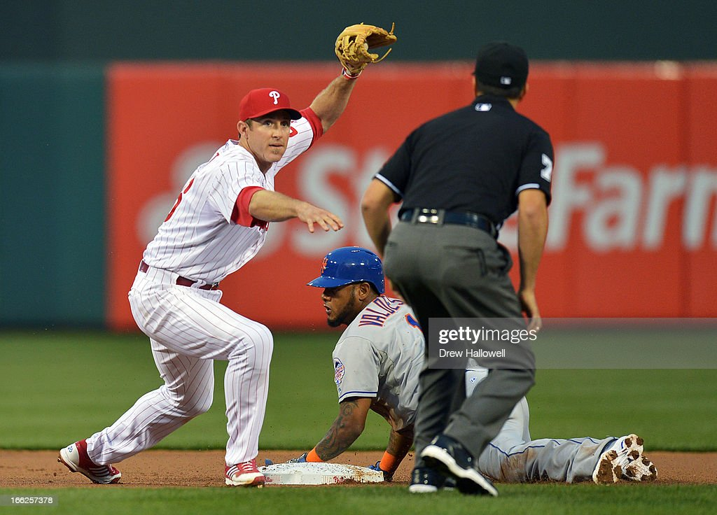<a gi-track='captionPersonalityLinkClicked' href=/galleries/search?phrase=Chase+Utley&family=editorial&specificpeople=161391 ng-click='$event.stopPropagation()'>Chase Utley</a> #26 of the Philadelphia Phillies loods to the umpire for the call after putting out Jordany Valdespin #1 of the New York Mets in the first inning at Citizens Bank Park on April 10, 2013 in Philadelphia, Pennsylvania.