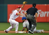 Chase Utley of the Philadelphia Phillies loods to the umpire for the call after putting out Jordany Valdespin of the New York Mets in the first...