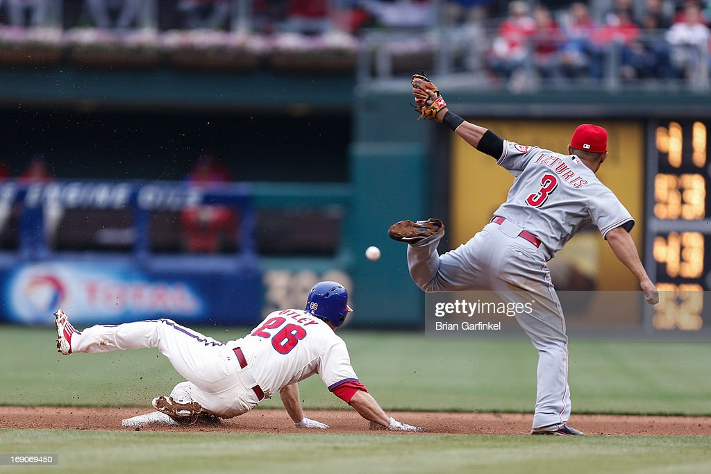 <a gi-track='captionPersonalityLinkClicked' href=/galleries/search?phrase=Chase+Utley&family=editorial&specificpeople=161391 ng-click='$event.stopPropagation()'>Chase Utley</a> #26 of the Philadelphia Phillies looks at an overthrown ball as he slides safely into second during the game against the Cincinnati Reds at Citizens Bank Park on May 19, 2013 in Philadelphia, Pennsylvania. The Phillies won 3-2.