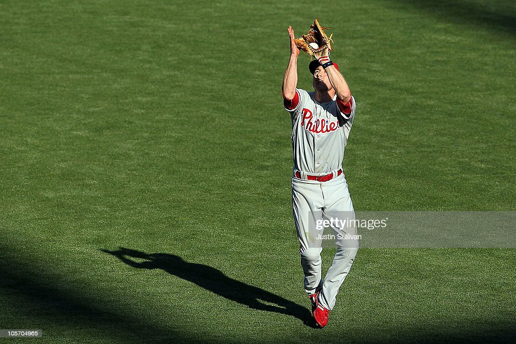 <a gi-track='captionPersonalityLinkClicked' href=/galleries/search?phrase=Chase+Utley&family=editorial&specificpeople=161391 ng-click='$event.stopPropagation()'>Chase Utley</a> #26 of the Philadelphia Phillies makes a catch on a pop fly from Buster Posey #28 of the San Francisco Giants in Game Three of the NLCS during the 2010 MLB Playoffs at AT&T Park on October 19, 2010 in San Francisco, California.