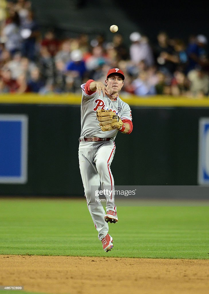 <a gi-track='captionPersonalityLinkClicked' href=/galleries/search?phrase=Chase+Utley&family=editorial&specificpeople=161391 ng-click='$event.stopPropagation()'>Chase Utley</a> #26 of the Philadelphia Phillies makes a leaping throw to first base in the third inning against the Arizona Diamondbacks at Chase Field on April 25, 2014 in Phoenix, Arizona.