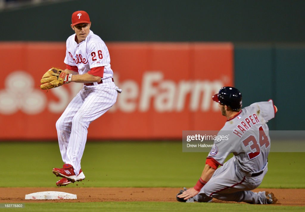 <a gi-track='captionPersonalityLinkClicked' href=/galleries/search?phrase=Chase+Utley&family=editorial&specificpeople=161391 ng-click='$event.stopPropagation()'>Chase Utley</a> #26 of the Philadelphia Phillies puts out <a gi-track='captionPersonalityLinkClicked' href=/galleries/search?phrase=Bryce+Harper&family=editorial&specificpeople=5926486 ng-click='$event.stopPropagation()'>Bryce Harper</a> #34 of the Washington Nationals at second base at Citizens Bank Park on September 25, 2012 in Philadelphia, Pennsylvania.