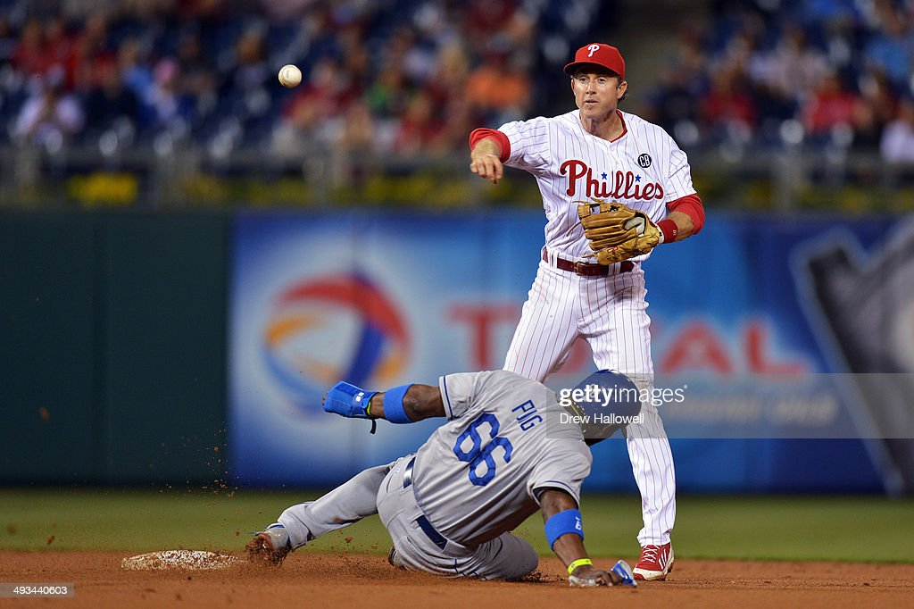 <a gi-track='captionPersonalityLinkClicked' href=/galleries/search?phrase=Chase+Utley&family=editorial&specificpeople=161391 ng-click='$event.stopPropagation()'>Chase Utley</a> #26 of the Philadelphia Phillies puts out <a gi-track='captionPersonalityLinkClicked' href=/galleries/search?phrase=Yasiel+Puig&family=editorial&specificpeople=10484087 ng-click='$event.stopPropagation()'>Yasiel Puig</a> #66 of the Los Angeles Dodgers on a double play in the seventh inning at Citizens Bank Park on May 23, 2014 in Philadelphia, Pennsylvania. The Dodgers won 2-0.