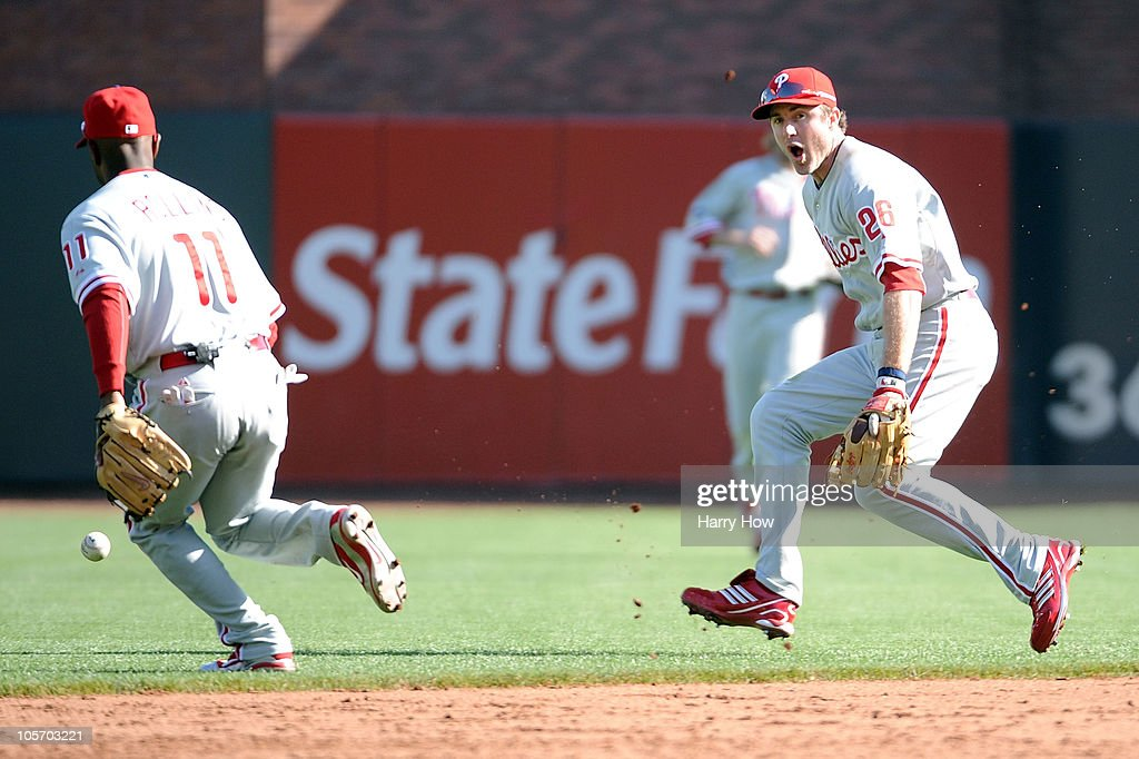 <a gi-track='captionPersonalityLinkClicked' href=/galleries/search?phrase=Chase+Utley&family=editorial&specificpeople=161391 ng-click='$event.stopPropagation()'>Chase Utley</a> #26 of the Philadelphia Phillies reacts after allowing an infield hit by Freddy Sanchez #21 of the San Francisco Giants in Game Three of the NLCS during the 2010 MLB Playoffs at AT&T Park on October 19, 2010 in San Francisco, California.