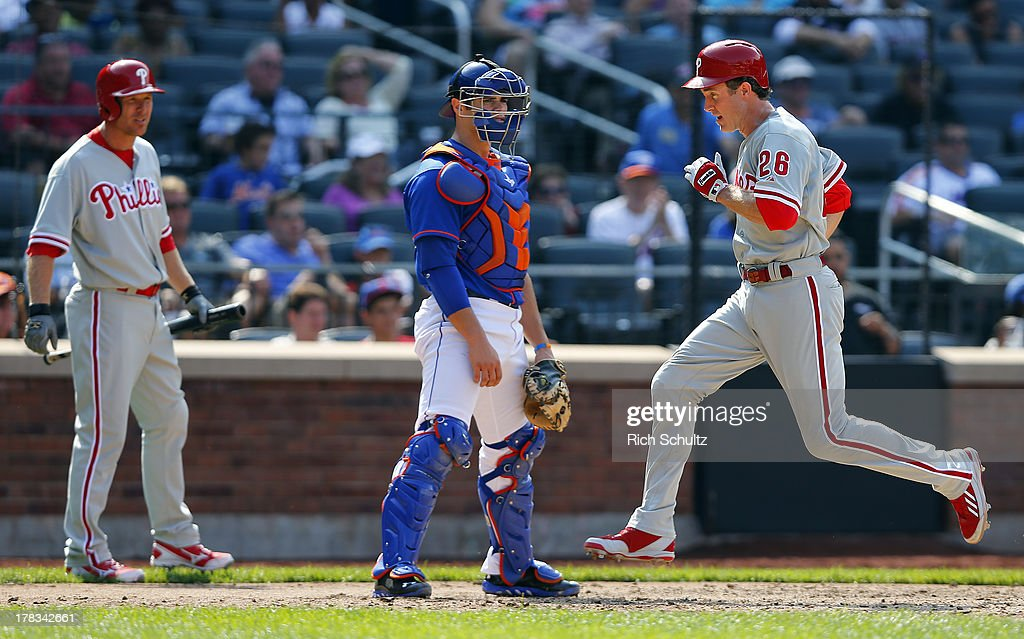 <a gi-track='captionPersonalityLinkClicked' href=/galleries/search?phrase=Chase+Utley&family=editorial&specificpeople=161391 ng-click='$event.stopPropagation()'>Chase Utley</a> #26 of the Philadelphia Phillies scores a a sacrifice fly hit by Darin Ruf #18 as catcher Anthony Recker #20 looks on in the seventh inning on August 29, 2013 at Citi Field in the Flushing neighborhood of the Queens borough of New York City.