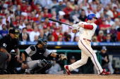 Chase Utley of the Philadelphia Phillies singles in the bottom of the sixth inning against the Colorado Rockies in Game Two of the NLDS during the...