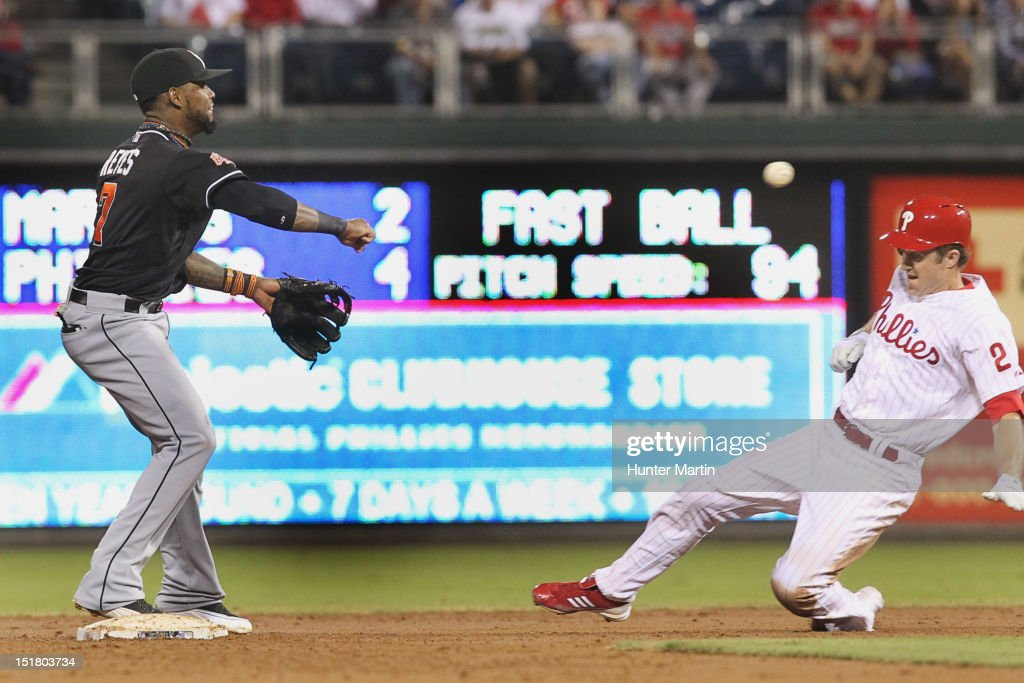 <a gi-track='captionPersonalityLinkClicked' href=/galleries/search?phrase=Chase+Utley&family=editorial&specificpeople=161391 ng-click='$event.stopPropagation()'>Chase Utley</a> #26 of the Philadelphia Phillies slides into second base as Jose Reyes #7 of the Miami Marlins throws to first during a game at Citizens Bank Park on September 11, 2012 in Philadelphia, Pennsylvania.
