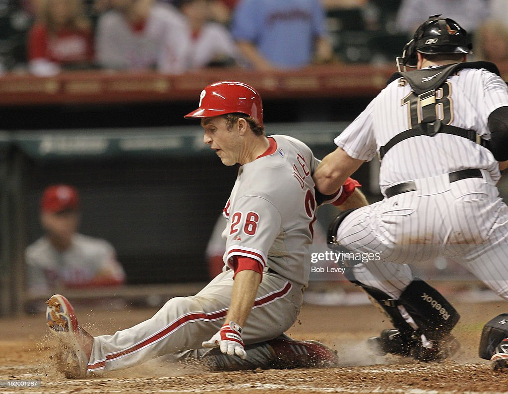 <a gi-track='captionPersonalityLinkClicked' href=/galleries/search?phrase=Chase+Utley&family=editorial&specificpeople=161391 ng-click='$event.stopPropagation()'>Chase Utley</a> #26 of the Philadelphia Phillies slides safely at home as <a gi-track='captionPersonalityLinkClicked' href=/galleries/search?phrase=Chris+Snyder&family=editorial&specificpeople=201238 ng-click='$event.stopPropagation()'>Chris Snyder</a> #18 of the Houston Astros applies the tag in the eighth inning at Minute Maid Park on September 14, 2012 in Houston, Texas.
