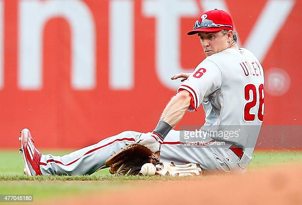 Chase Utley of the Philadelphia Phillies slides to field a ground ball against the Pittsburgh Pirates in the sixth inning during the game at PNC Park...