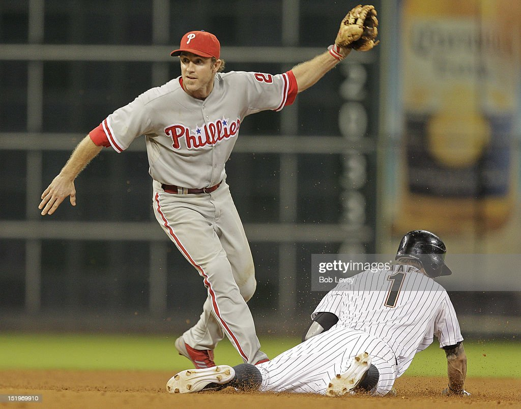 <a gi-track='captionPersonalityLinkClicked' href=/galleries/search?phrase=Chase+Utley&family=editorial&specificpeople=161391 ng-click='$event.stopPropagation()'>Chase Utley</a> #26 of the Philadelphia Phillies tags out <a gi-track='captionPersonalityLinkClicked' href=/galleries/search?phrase=Jordan+Schafer&family=editorial&specificpeople=4958028 ng-click='$event.stopPropagation()'>Jordan Schafer</a> #1 of the Houston Astros on a steal attempt at second base in the eighth inning at Minute Maid Park on September 13, 2012 in Houston, Texas. Houston wins 6-4.