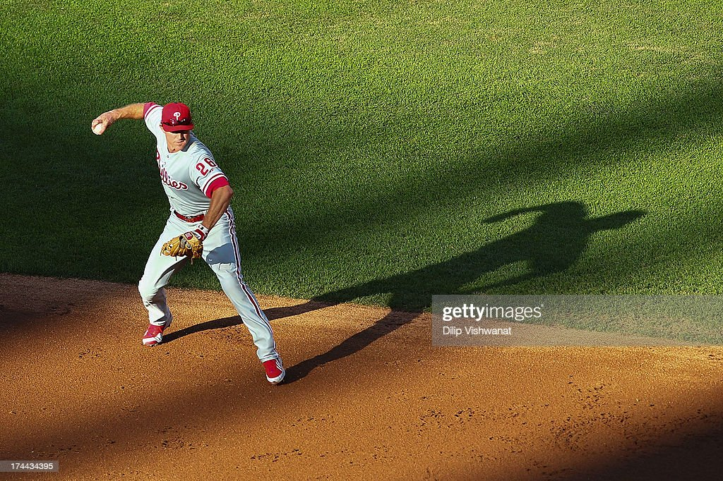 <a gi-track='captionPersonalityLinkClicked' href=/galleries/search?phrase=Chase+Utley&family=editorial&specificpeople=161391 ng-click='$event.stopPropagation()'>Chase Utley</a> #26 of the Philadelphia Phillies throws out a runner against the St. Louis Cardinals in the second inning at Busch Stadium on July 25, 2013 in St. Louis, Missouri.
