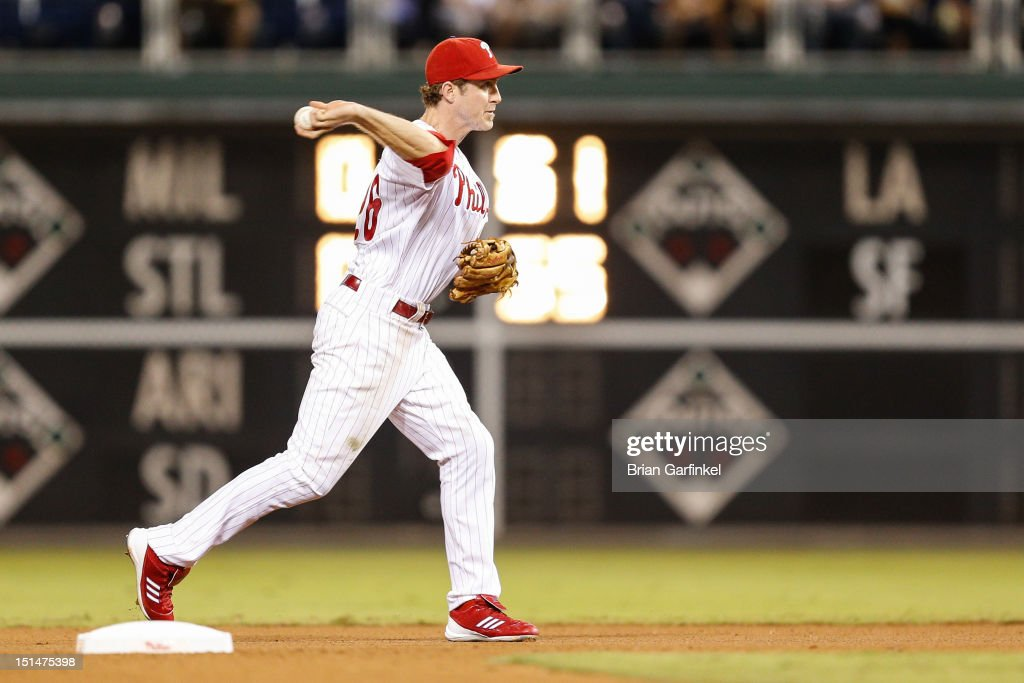 <a gi-track='captionPersonalityLinkClicked' href=/galleries/search?phrase=Chase+Utley&family=editorial&specificpeople=161391 ng-click='$event.stopPropagation()'>Chase Utley</a> #26 of the Philadelphia Phillies throws the ball to first base in the seventh inning of the game against the Colorado Rockies at Citizens Bank Park on September 7, 2012 in Philadelphia, Pennsylvania. The Phillies won 3-2.