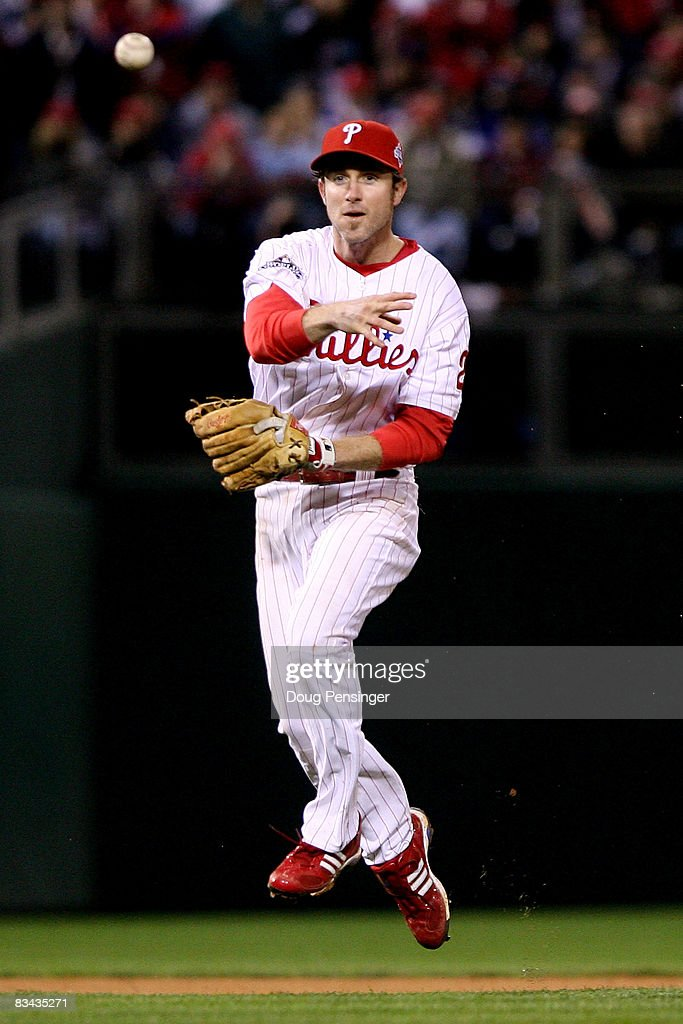 Chase Utley #26 of the Philadelphia Phillies throws to first against the Tampa Bay Rays during game three of the 2008 MLB World Series on October 25, 2008 at Citizens Bank Park in Philadelphia, Pennsylvania.