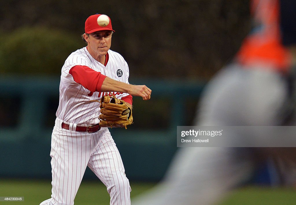 <a gi-track='captionPersonalityLinkClicked' href=/galleries/search?phrase=Chase+Utley&family=editorial&specificpeople=161391 ng-click='$event.stopPropagation()'>Chase Utley</a> #26 of the Philadelphia Phillies throws to first to put out Christian Yelich #21 of the Miami Marlins in the first inning at Citizens Bank Park on April 11, 2014 in Philadelphia, Pennsylvania.