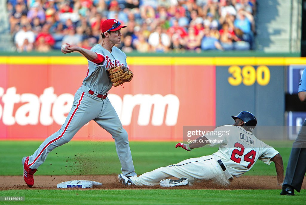 <a gi-track='captionPersonalityLinkClicked' href=/galleries/search?phrase=Chase+Utley&family=editorial&specificpeople=161391 ng-click='$event.stopPropagation()'>Chase Utley</a> #26 of the Philadelphia Phillies turns a double play against <a gi-track='captionPersonalityLinkClicked' href=/galleries/search?phrase=Michael+Bourn&family=editorial&specificpeople=835742 ng-click='$event.stopPropagation()'>Michael Bourn</a> #24 of the Atlanta Braves at Turner Field on September 2 2012 in Atlanta, Georgia.