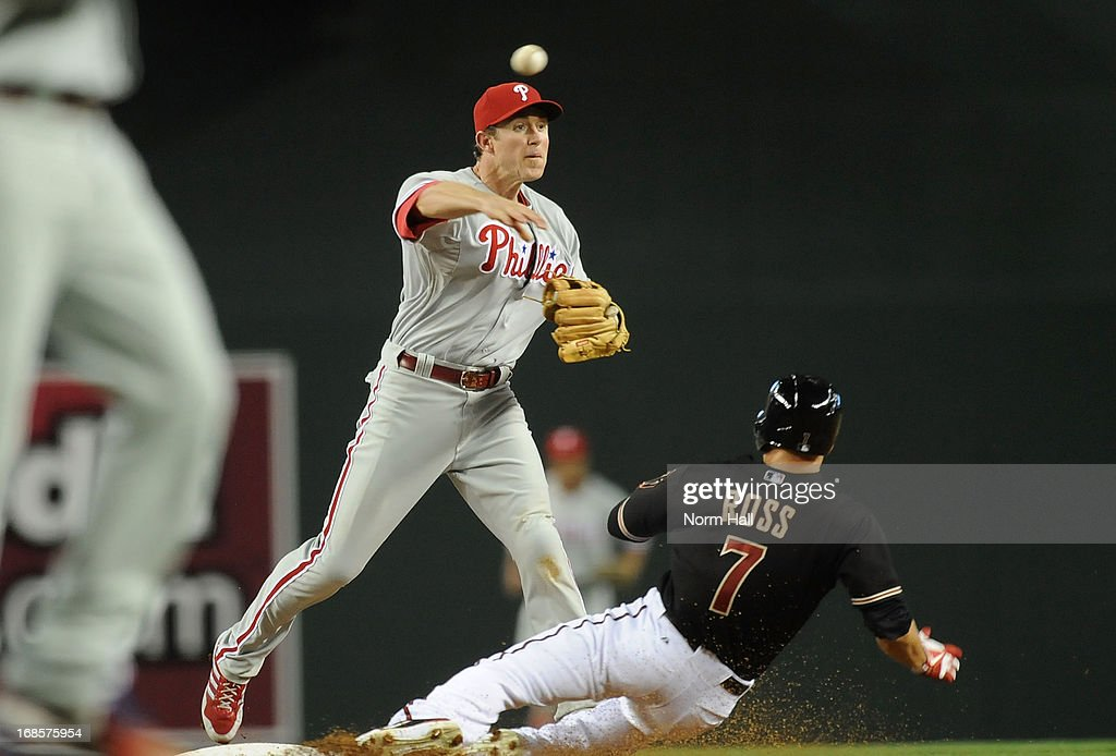 <a gi-track='captionPersonalityLinkClicked' href=/galleries/search?phrase=Chase+Utley&family=editorial&specificpeople=161391 ng-click='$event.stopPropagation()'>Chase Utley</a> #26 of the Philadelphia Phillies turns a double play as <a gi-track='captionPersonalityLinkClicked' href=/galleries/search?phrase=Cody+Ross&family=editorial&specificpeople=545810 ng-click='$event.stopPropagation()'>Cody Ross</a> #7 of the Arizona Diamondbacks slides into second base at Chase Field on May 11, 2013 in Phoenix, Arizona.