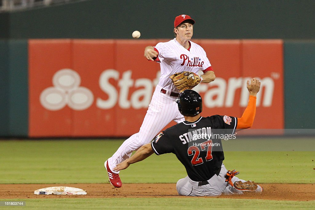<a gi-track='captionPersonalityLinkClicked' href=/galleries/search?phrase=Chase+Utley&family=editorial&specificpeople=161391 ng-click='$event.stopPropagation()'>Chase Utley</a> #26 of the Philadelphia Phillies turns a double play as <a gi-track='captionPersonalityLinkClicked' href=/galleries/search?phrase=Giancarlo+Stanton&family=editorial&specificpeople=8983978 ng-click='$event.stopPropagation()'>Giancarlo Stanton</a> #27 of the Miami Marlins slides into second base during a game at Citizens Bank Park on September 11, 2012 in Philadelphia, Pennsylvania.