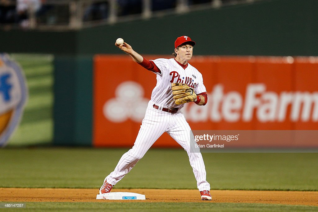 <a gi-track='captionPersonalityLinkClicked' href=/galleries/search?phrase=Chase+Utley&family=editorial&specificpeople=161391 ng-click='$event.stopPropagation()'>Chase Utley</a> of the Philadelphia Phillies turns a double play in the fourth inning of the game against the Atlanta Braves at Citizens Bank Park on April 16, 2014 in Philadelphia, Pennsylvania. All uniformed team members are wearing jersey number 42 in honor of Jackie Robinson Day.