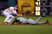Chase Utley of the Philadelphia Phillies waits for the ball to tag out Dexter Fowler of the Colorado Rockies on a steal in the seventh inning at...
