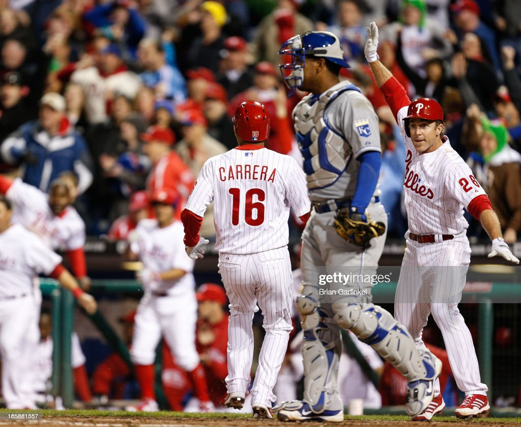 <a gi-track='captionPersonalityLinkClicked' href=/galleries/search?phrase=Chase+Utley&family=editorial&specificpeople=161391 ng-click='$event.stopPropagation()'>Chase Utley</a> #26 of the Philadelphia Phillies waves Michael Young #10 home for the third run in the bottom of the ninth inning off of a Kevin Frandsen three RBI double to win the game against the Kansas City Royals at Citizens Bank Park on April 6, 2013 in Philadelphia, Pennsylvania. The Phillies won 4-3.