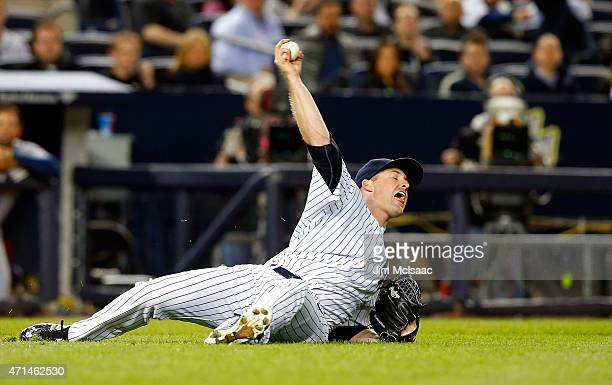 Chase Whitley of the New York Yankees fields the ball and holds his throw on a bunt single by Asdrubal Cabrera of the Tampa Bay Rays in the fifth...