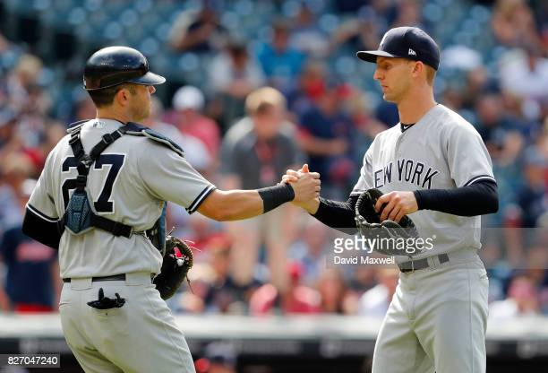 Chasen Shreve of the New York Yankees celebrates with Austin Romine after defeating the Cleveland Indians at Progressive Field on August 6 2017 in...