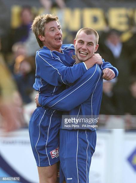 Chasetown's Ben Steane and Craig Holland celebrate the opening goal of the game an own goal scored by Cardiff City's Kevin McNaughton