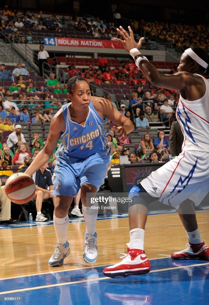 Chasity Melvin of the Chicago Sky looks to maneuver against Cheryl Ford of the Detroit Shock during the WNBA game on July 16 2008 at The Palace of...
