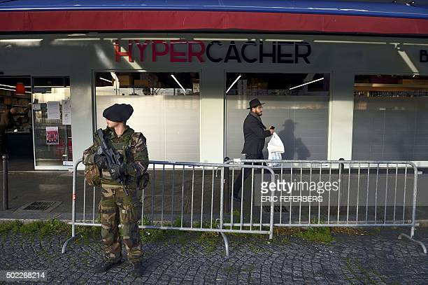 A Chasseur Alpin French soldier stands guard in front of the Hypercacher kosher supermarket on December 22 2015 in Paris nearly a year after a bloody...