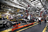 A chassis for a Chrysler Ram 1500 truck goes through the assembly line at the Warren Truck Assembly Plant September 25 2014 in Warren Michigan The...