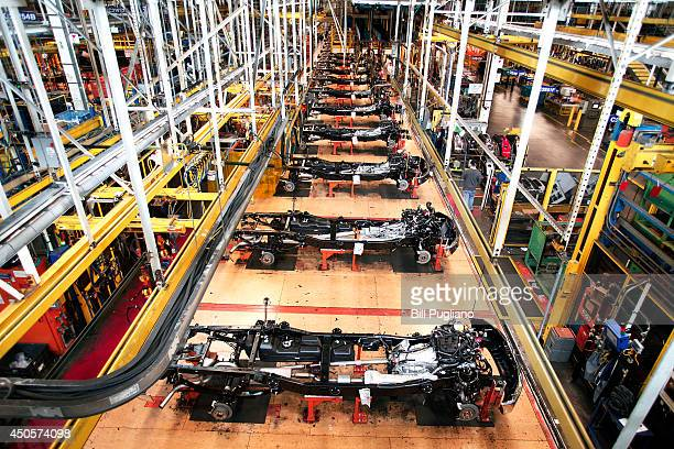Chassis for new 2014 Ford F150 trucks undergo assembly at the Ford Dearborn Truck Plant June 13 2014 in Dearborn Michigan Production for the 2015...
