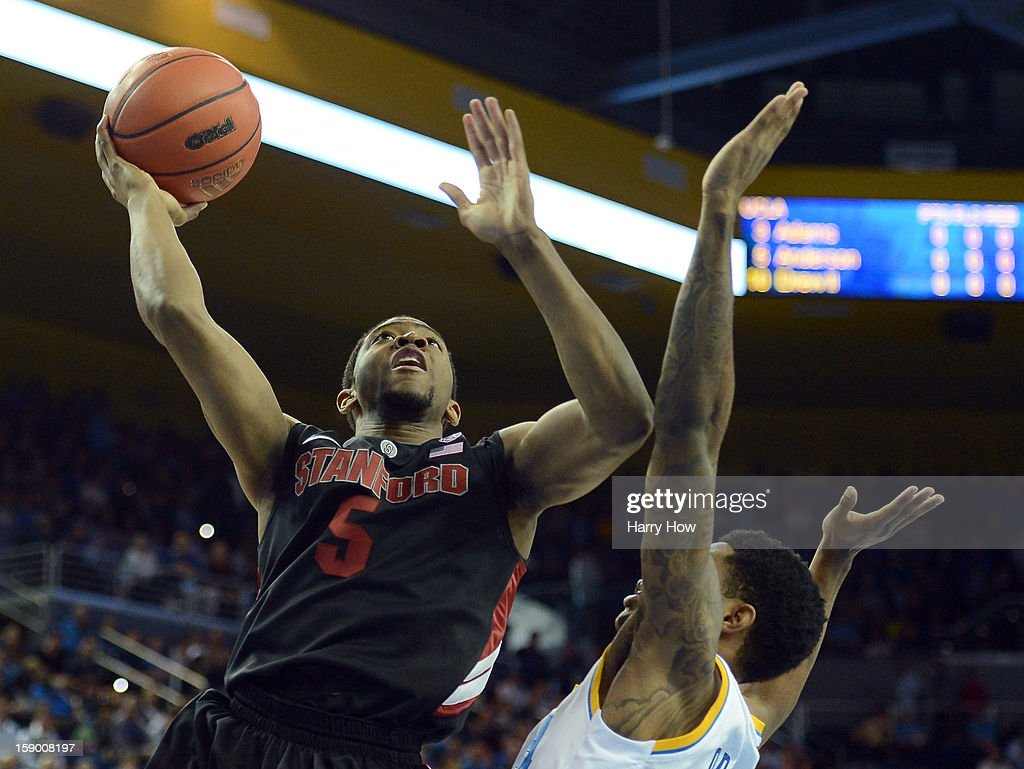 Chasson Randle #5 of the Stanford Cardinal attempts a layup over Larry Drew II #10 of the UCLA Bruins at Pauley Pavilion on January 5, 2013 in Los Angeles, California.