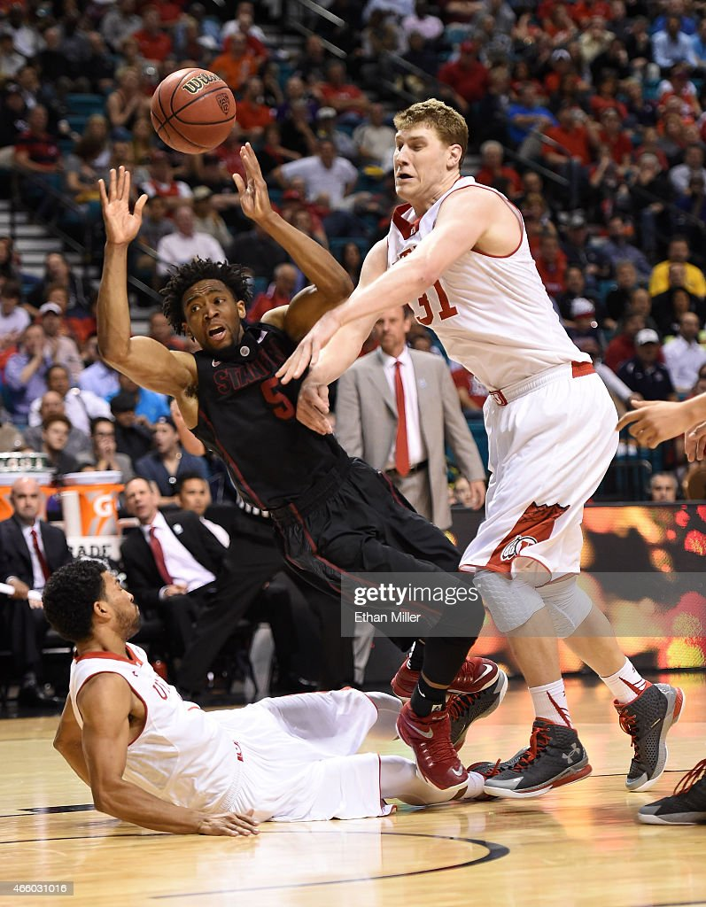 Chasson Randle #5 of the Stanford Cardinal is fouled by Isaiah Wright #1 (L) of the Utah Utes as Dallin Bachynski #31 of the Utes defends during a quarterfinal game of the Pac-12 Basketball Tournament at the MGM Grand Garden Arena on March 12, 2015 in Las Vegas, Nevada.