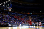 Chasson Randle of the Stanford Cardinal shoots a free throw from a technical foul by the New Mexico Lobos late in the second half during the second...